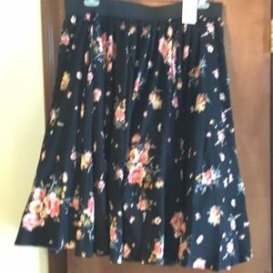 Full skirt, black with pink floral pattern